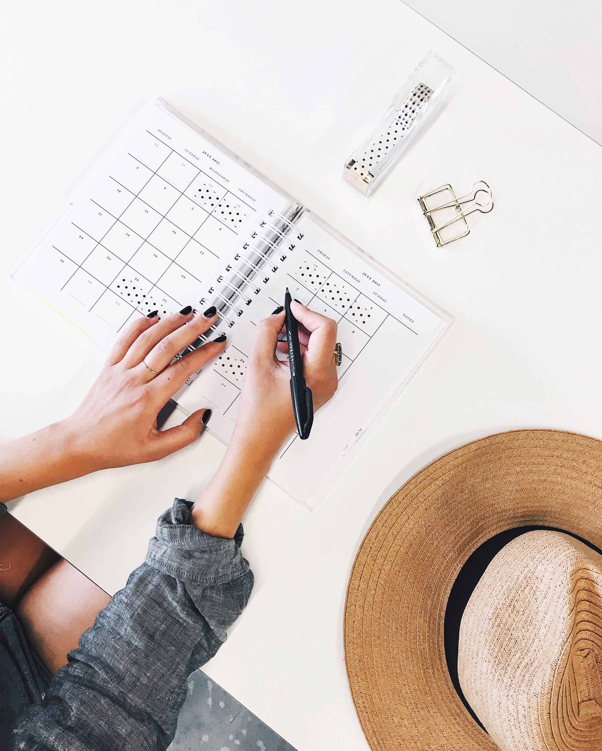 stay organized, mom with calendar and planner