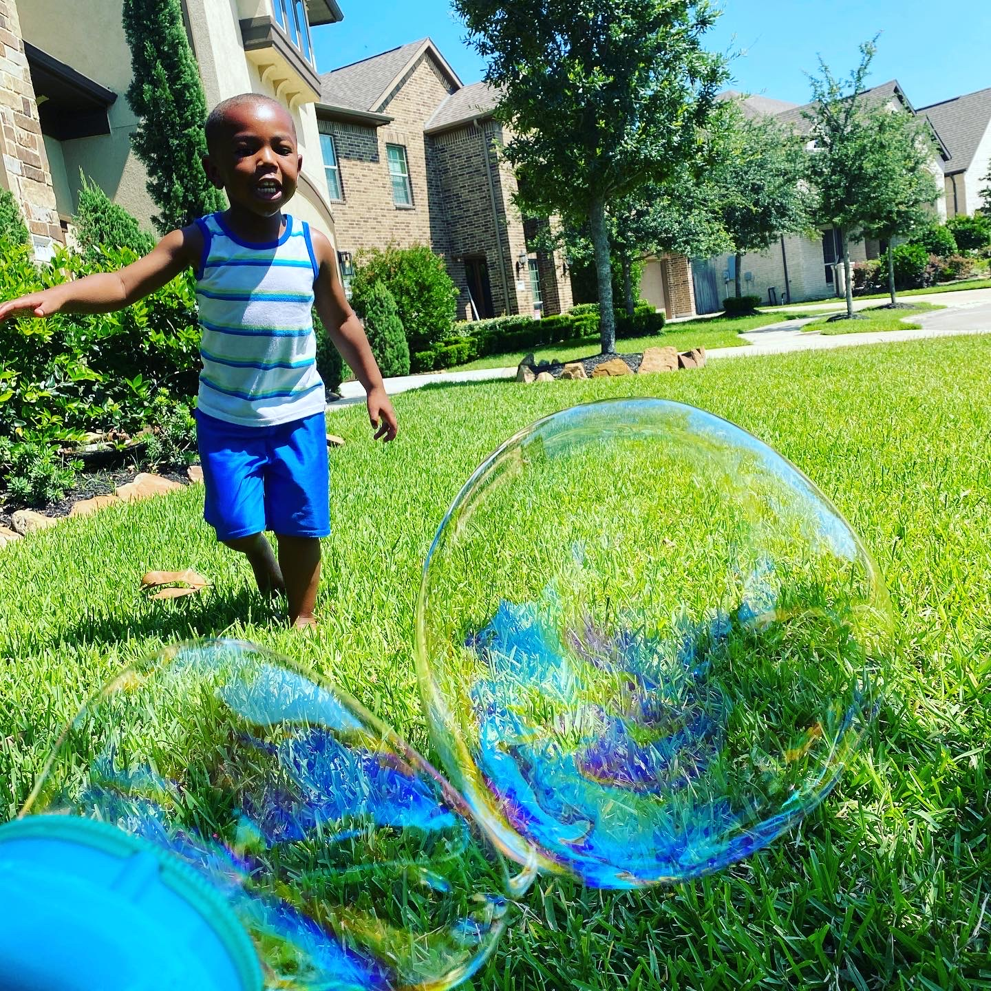 little boy with bubbles, good in a hard situation
